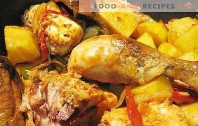 Frango assado com batatas em um fogão lento